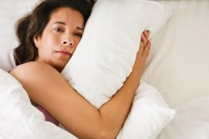Woman experiencing sleeping trouble